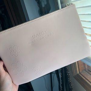Marc Jacobs travel bag, makeup bag, clutch.